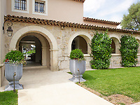 The house is built in traditional style and has a colour scheme of pinkish-beige to harmonise with the warm stone walls
