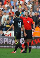 Saturday, 20 October 2012<br /> Pictured L-R: Jordi Gomez of Wigan sees a yellow card by match referee M Jones<br /> Re: Barclays Premier League, Swansea City FC v Wigan Athletic at the Liberty Stadium, south Wales.