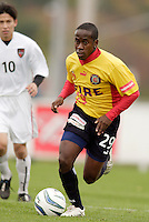 Thiago of the Fire is watched by Joselito Vaca of the MetroStars. The MetroStars defeated the Chicago Fire 2-0 during the inaugural Hall of Fame game on Monday October 11, 2004 at At-A-Glance Field at the National Soccer Hall of Fame and Museum, Oneonta, NY..