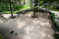 The dog run in Theodore Roosevelt Park in the Upper West Side neighborhood of New York on Sunday, July 17, 2016. (© Richard B. Levine)