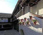 Balcony in historic courtyard housing the Fosforito flamenco museum, Cordoba, Spain