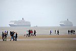 Cunard Line's Three Queens Meeting Liverpool. <br /> Crosby Beach 25.5.15. Queen Elizabeth and Queen Victoria make their way into Liverpool.