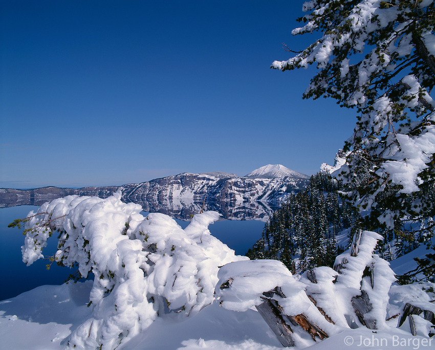 67ORCL_06 - USA, Oregon, Crater Lake National Park, Winter snow accumulates at Crater Lake and on distant Mount Scott.