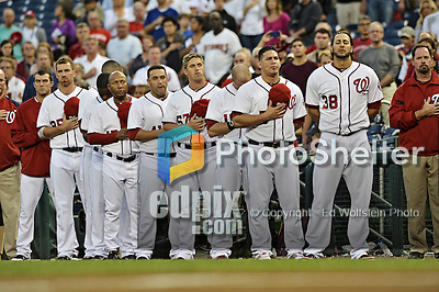 20 September 2012: Members of the Washington Nationals stand at attention during the playing of the National Anthem prior to a game against the Los Angeles Dodgers at Nationals Park in Washington, DC. The Nationals defeated the Dodgers 4-1, clinching a playoff birth: the first time for a Washington franchise since 1933. Mandatory Credit: Ed Wolfstein Photo