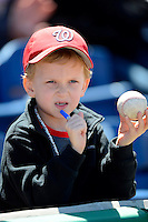 Washington Nationals young fan looking for autographs before a Spring Training game against the Philadelphia Phillies at Bright House Field on March 6, 2013 in Clearwater, Florida.  Philadelphia defeated Washington 6-3.  (Mike Janes/Four Seam Images)