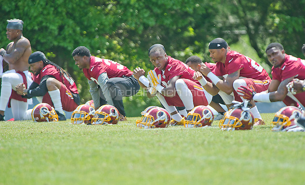 Washington Redskins players participate in warm-up drills during an organized team activity (OTA) at Redskins Park in Ashburn, Virginia on Wednesday, May 25, 2015.<br /> Credit: Ron Sachs / CNP/MediaPunch ***FOR EDITORIAL USE ONLY***