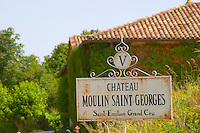 A white sign saying Chateau Moulin Saint Georges Saint Emilion Grand Cru Saint Emilion Bordeaux Gironde Aquitaine France