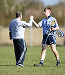 Scariff Community College manager Sean Mc Namara congratulates Martin Walsh as her returns to the dug out late on during their All-Ireland Colleges final at Toomevara. Photograph by John Kelly.
