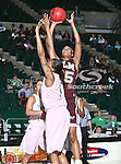 University of Louisiana at Monroe Warhawks center Larrie Williams (35) goes up for a jump shot over North Texas Mean Green forward Ash'Lynne Evans (1) during the NCAA Women's basketball game between the University of Louisiana at Monroe Warhawks and the University of North Texas Mean Green at the North Texas Coliseum,the Super Pit, in Denton, Texas. ULM defeated UNT 50 to 47.