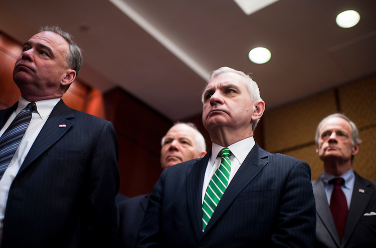 "UNITED STATES - FEBRUARY 24: From left, Sens. Tim Kaine, D-Va., Ben Cardin, D-Md., Jack Reed, D-R.I., and Tom Carper, D-Del., listen during the Senate Democratic Caucus' news conference with first responders to discuss support for a ""clean bill"" to fund the Homeland Security Department on Tuesday, Feb. 24, 2015. (Photo By Bill Clark/CQ Roll Call)"
