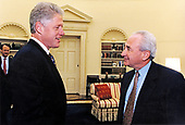 United States President Bill Clinton meets with Jay Berman, recently appointed Special Counselor to coordinate the Administration's efforts in securing fast track authority in the Oval Office of the White House on July 24, 1997.  The fast track authority allows the President to negotiate international agreements that can either be approved or denied by Congress but cannot be amended or filibustered.<br /> Mandatory Credit: Ralph Alswang / White House via CNP