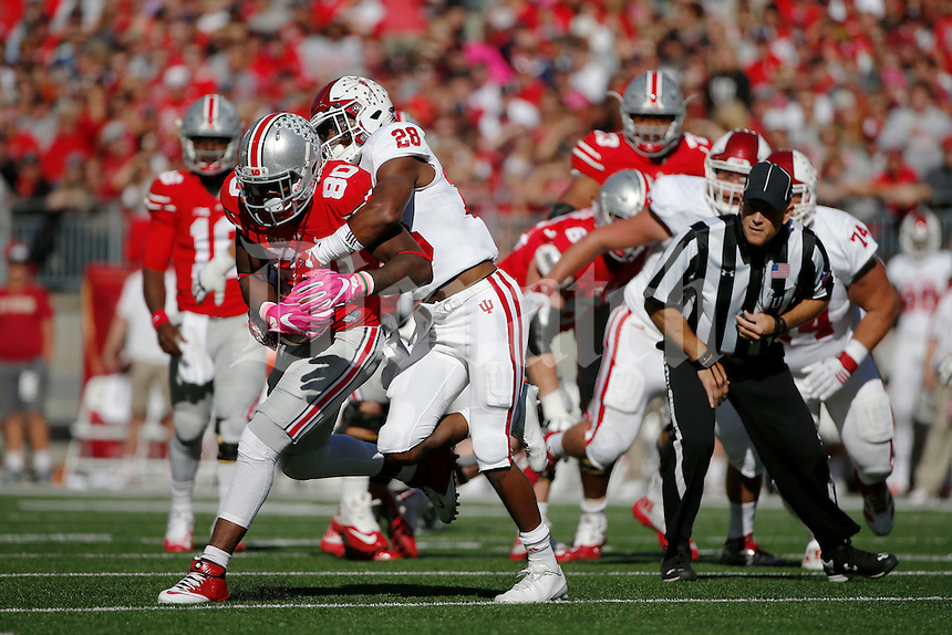Ohio State Buckeyes wide receiver Noah Brown (80) fights for extra yards as Indiana Hoosiers defensive back AShon Riggins (28) tackles during the first quarter of a NCAA Division I college football game between the Ohio State Buckeyes and the Indiana Hoosiers on Saturday, October 8, 2016 at Ohio Stadium in Columbus, Ohio. (Joshua A. Bickel/The Columbus Dispatch)