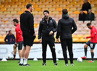 Lincoln City manager Danny Cowley, centre in conversation with Lincoln City's first team coach/under 23 manager Jamie McCombe, left and Nicky Cowley<br /> <br /> Photographer Andrew Vaughan/CameraSport<br /> <br /> The EFL Sky Bet League Two - Port Vale v Lincoln City - Saturday 13th October 2018 - Vale Park - Burslem<br /> <br /> World Copyright © 2018 CameraSport. All rights reserved. 43 Linden Ave. Countesthorpe. Leicester. England. LE8 5PG - Tel: +44 (0) 116 277 4147 - admin@camerasport.com - www.camerasport.com