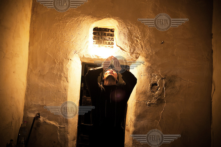 A Muslim inmate with MDR TB (multi-drug-resistant tuberculosis), prays in his 6m2 cell. He is an inmate of Prison Colony 27. Kyrgyzstan's prisons are experiencing a TB epidemic, where the incidence rate is estimated at 25 times higher than in civil society.