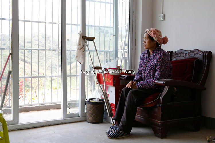 A poor and sick farmer of the ethnic Bouyei Tribe from rural area is relocated to a new unit of government housing at Wangmo County in China's southwestern Guizhou Province, April 2019.