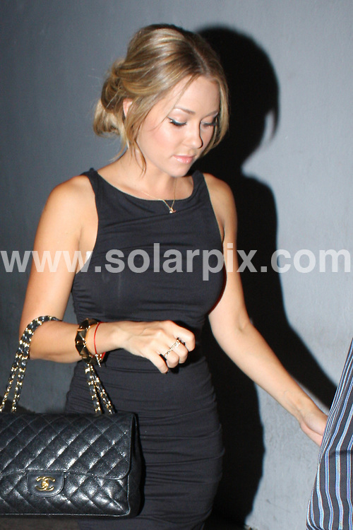**ALL ROUND PICTURES FROM SOLARPIX.COM**.**WORLDWIDE SYNDICATION RIGHTS**.**NO PUBLICATION IN AUSTRALIA, DENMARK, GERMANY, NEW ZEALAND, RUSSIA, OR USA**.Lauren Conrad with her Mom and Dad for dinner at Beso Restaurant in Hollywood.  Lauren was dressed to impress except for the bra malfunction taking attention away from her stylish ensemble. West Hollywood, USA. 29th August 2008..This pic: Lauren Conrad..JOB REF: 7162  LAP(HD)       DATE: 29_08_2008.**MUST CREDIT SOLARPIX.COM OR DOUBLE FEE WILL BE CHARGED* *UNDER NO CIRCUMSTANCES IS THIS IMAGE TO BE REPRODUCED FOR ANY ONLINE EDITION WITHOUT PRIOR PERMISSION*