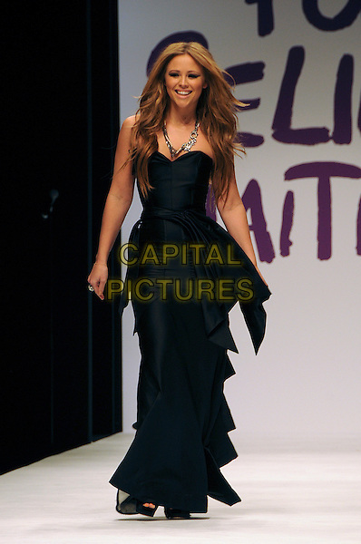 KIMBERLEY WALSH.The Fashion For Relief Haiti 2010 show for London Fashion Week Autumn/Winter 2010 at Somerset House, London, England..February 18th, 2010.LFW catwalk runway full length black maxi dress gathered kimberly  .CAP/CAS.©Bob Cass/Capital Pictures.