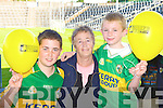 Darren McGinley, Anne McGinley and Tadgh Kerins Tralee with their Kerry's Eye balloons at the Kerry team training in Fitzgerald Stadium, Killarney on Saturday. .