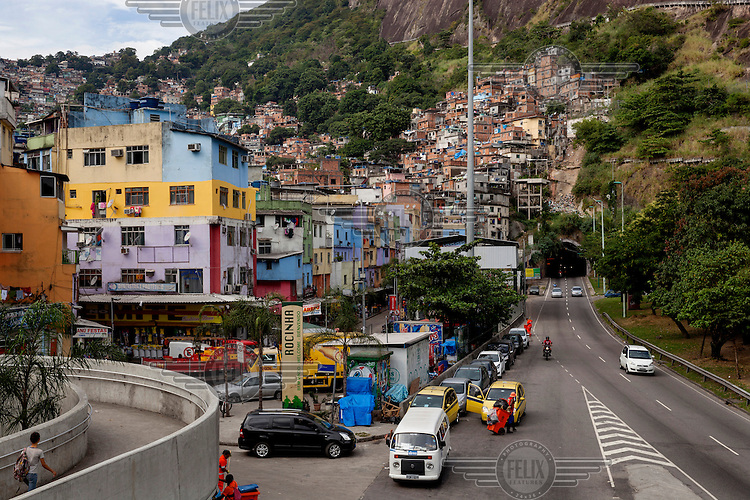 The Rocinha favela with the AutoEstrada Lagoa-Barra and the entrance to the Tunel Zuzu Angel to the right.