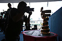 A press photographer photographs the Giro d'Italia trophy at Belfast's Waterfront Hall, Belfast, Northern Ireland, Friday 9th May, 2014. Ireland will host three days of cycling action from 9 to 11 May 2014.