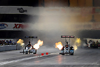 Nov 13, 2010; Pomona, CA, USA; NHRA top fuel dragster driver Terry McMillen (right) races alongside Chris Karamesines during qualifying for the Auto Club Finals at Auto Club Raceway at Pomona. Mandatory Credit: Mark J. Rebilas-