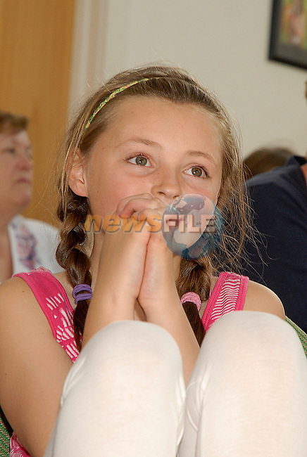 Leah McQuillan (11) listens to the speeches at the Moneymore After School  Club prizegiving. www.newsfile.ie