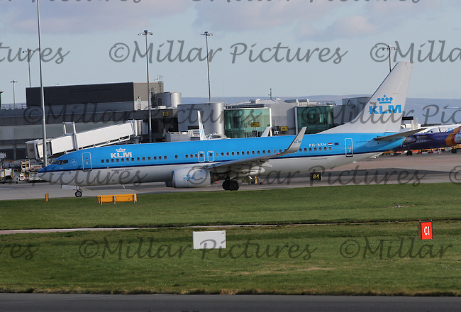 A KLM Boeing 737-8K2 Registration PH-BXM named Avocet taxying at Manchester Airport on 14.2.16 bound for Amsterdam Schipol Airport.