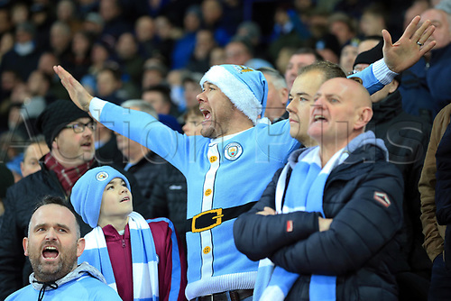 19th December 2017, King Power Stadium, Leicester, England; Carabao Cup quarter-final, Leicester City versus Manchester City; Manchester City in a blue Santa costume in full voice