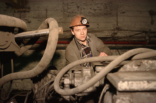 An engineer at work maintaining machinery at the October mine near Norilsk. Western Siberia, Russia.