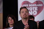 British comedian Eddie Izzard applauding whilst listening to speeches at an anti-Scottish independence Better Together campaign rally at Community Central Hall, Glasgow. The event was staged by Better Together who were campaigning to prevent an independent Scotland from leaving the United Kingdom. On the 18th of September 2014, the people of Scotland voted in a referendum to decide whether the country's union with England should continue or Scotland should become an independent nation once again.