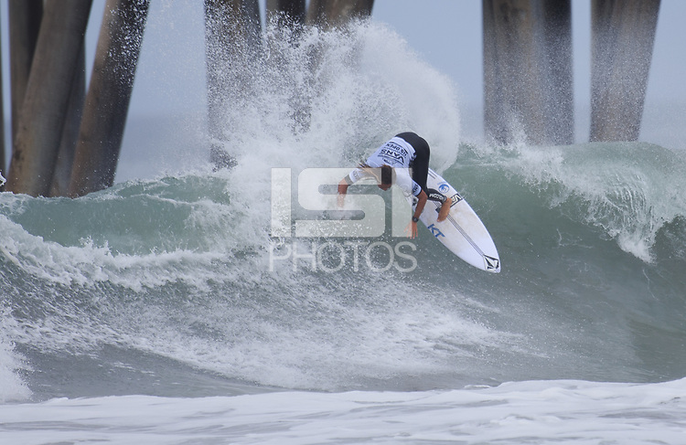 Huntington Beach, CA - Sunday July 30, 2017: Imaikalani Devault during a Qualifying Series (QS) trials round heat in the 2017 Vans US Open of Surfing on the South side of the Huntington Beach pier.