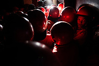A group of the 600 Red Ants gathered for an eviction of squatters from a 10-storey building called Fatti's Mansions on Jeppe Street in the Johannesburg CBD. The Red Ants are a controversial private security company often hired to clear squatters from land and so-called 'hijacked' properties.