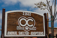 "Wooden sign for the Orange County Humane Society's new shelter on Newland street in Huntingon Beach, CA.  The sign reads ""Animal Shelter - Adoptions"", and is easily visible from the street as you approach."