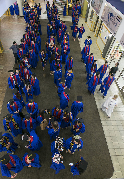Students line up, two-by-two, in the Student Center on the Lincoln Park Campus as they prepare to process over to the Saint Vincent de Paul Parish Church on DePaul University's Lincoln Park Campus for the annual Baccalaureate Mass Friday, June 9, 2017. The event was part of the 119th commencement ceremonies for the Chicago university. (DePaul University/Jamie Moncrief)