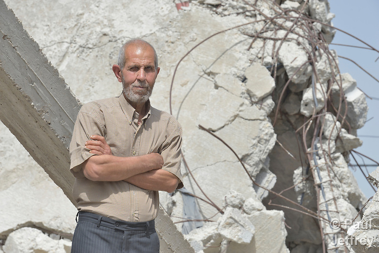 Najeeb Zaneen stands amid the rubble of his house in Beit Hanoun, Gaza. A farmer, his home was destroyed by an Israeli air strike in 2014. He has received assistance in reestablishing his farm from International Orthodox Christian Charities, a member of the ACT Alliance.