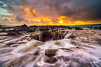 waves, crashing into a blowhole, at sunset, located at Mokolea Point, Kilauea National Wildlife Refuge, Kauai, Hawaii, USA, Pacific Ocean