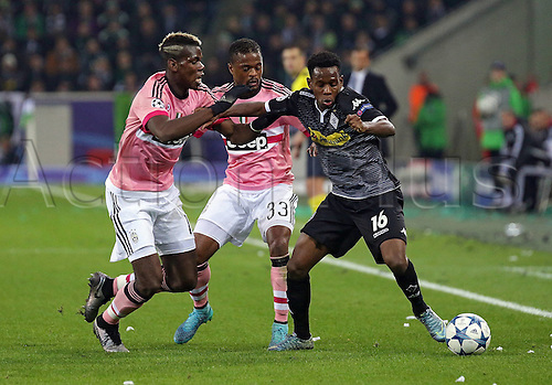 03.11.2015. Moenchengladbach, Germany, UEFA Champions League football group stages. Borussia Moenchangladbach versus Juventus.  Paul Pogba (Juventus Turin), Patrice Evra (Juventus Turin), Ibrahima Traore (Borussia Moenchengladbach)