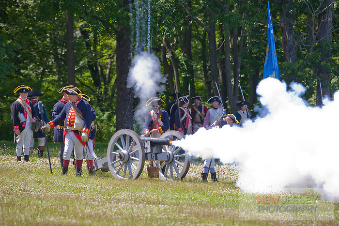 Continental and British Army reenactors exchanging cannon fire, Revolutionary War, Monmouth Battlefield State Park, New Jersey
