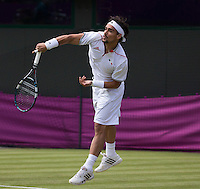 Fabio Fognini - Italy..Tennis - OLympic Games -Olympic Tennis -  London 2012 -  Wimbledon - AELTC - The All England Club - London - Friday 29th June  2012. .© AMN Images, 30, Cleveland Street, London, W1T 4JD.Tel - +44 20 7907 6387.mfrey@advantagemedianet.com.www.amnimages.photoshelter.com.www.advantagemedianet.com.www.tennishead.net