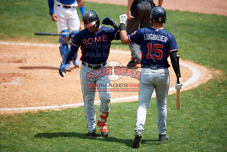 Rome Braves left fielder Jefrey Ramos (22) celebrates with Drew Lugbauer (15) after hitting a fourth inning home run during a game against the Lexington Legends on May 23, 2018 at Whitaker Bank Ballpark in Lexington, Kentucky.  Rome defeated Lexington 4-1.  (Mike Janes/Four Seam Images)