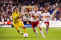 Jan Gunnar Solli (8) of the New York Red Bulls looks to hold off Sebastian Miranda (21) of the Columbus Crew. The New York Red Bulls defeated the Columbus Crew 3-1 during a Major League Soccer (MLS) match at Red Bull Arena in Harrison, NJ, on September 15, 2012.