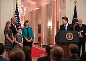 United States President Donald J. Trump, Ashley Kavanaugh, and daughters Liza and Margaret look on from the left as Associate Justice of the US Supreme Court Brett Kavanaugh, center right, gets emotional as he makes remarks after taking the Judicial Oath during a ceremony in the East Room of the White House in Washington, DC on Monday, October 8, 2018.  Kavanaugh formally took the oath on Saturday, hours after he was confirmed by the US Senate.  Former Associate Justice of the Supreme Court Anthony M. Kennedy looks on from the right.<br /> Credit: Ron Sachs / CNP<br /> (RESTRICTION: NO New York or New Jersey Newspapers or newspapers within a 75 mile radius of New York City)
