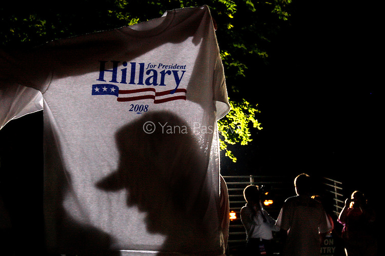 A vendor sells T-shirts endorsing U.S. Presidential hopeful Hillary Clinton (D-NY), while she campaigns with her husband, former President Bill Clinton, at the Iowa State Fairgrounds in Des Moines, Iowa, on July 2, 2007.