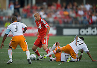 18 July 2009: Toronto FC forward Danny Dichio #9 appears to be surrounded by Houston Dynamo defender Julius James #3 and Houston Dynamo  midfielder Ricardo Clark #13 during a game between the Toronto FC and Houston Dynamo..The game ended in a 1-1 draw..