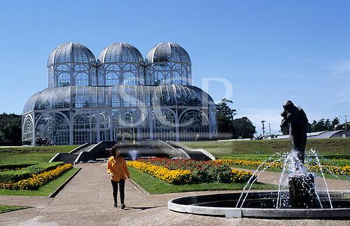 Curitiba, Brazil. Botanic Gardens; Glass house by Francisca Rischbieter, steel frame with transparent polycarbonate.