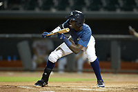 Ronny Mauricio (2) of the Columbia Fireflies squares to bunt against the Rome Braves at Segra Park on May 13, 2019 in Columbia, South Carolina. The Fireflies defeated the Braves 6-1 in game two of a doubleheader. (Brian Westerholt/Four Seam Images)