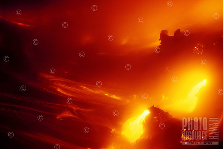 Lava flow from Kilauea Volcano as it enters the Pacific Ocean. Hawaii Volcanoes National Park.