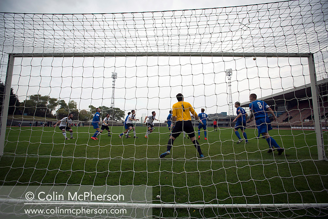 The home team players challenging for the ball from a corner kick at Meadowbank Stadium in Edinburgh, as Edinburgh City (in white) played host to Spartans in a Lowland League fixture. The host won the match 1-0 with a late goal by Ousman See, despite playing for the last 30 minutes with 10 men after Ross Allum was sent off. The wind kept the reigning champions side clear at the top of the league.
