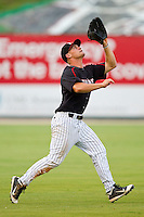 Left fielder Brady Shoemaker #21 of the Kannapolis Intimidators tracks a fly ball against the Greensboro Grasshoppers at Fieldcrest Cannon Stadium on June 19, 2011 in Kannapolis, North Carolina.  The Intimidators defeated the Grasshoppers 9-7.   (Brian Westerholt / Four Seam Images)