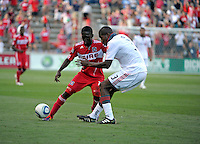 Toronto defender Andy Iro (3) pressures Chicago forward Patrick Nyarko (14).  The Chicago Fire defeated Toronto FC 2-0 at Toyota Park in Bridgeview, IL on August 21, 2011.